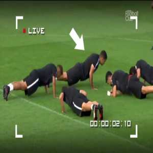 Hatem Ben Arfa pretending to do pushups during training