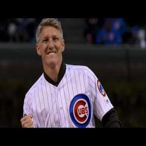 Bastian Schweinsteiger throws out the first pitch at a Chicago Cubs game