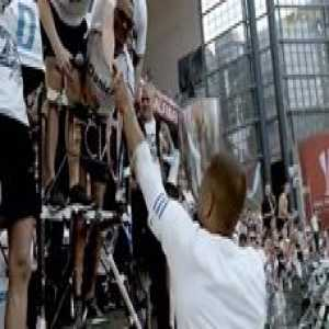 FC Kopenhagen celebrating by giving the pokal to the fans, one of the ultras then goes on to let a disabled fan lift the trophy. That's what soccer is all about!