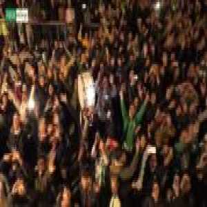 Real Betis players and a huge group of fans celebrating their derby victory over Sevilla