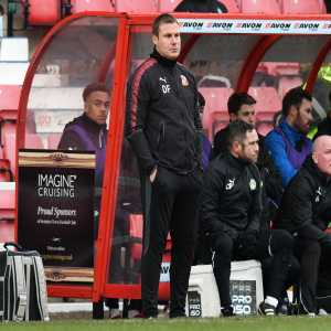 Swindon Town Managers face makes an optical illusion (it's actually 2 people)