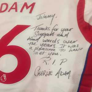 A Stoke City shirt personally signed by Charlie Adam has been left by Jimmy Armfield's statue