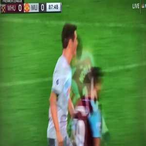 Mark Noble grabbing Pogba by the face