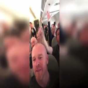 The fans of Liverpool have a great time on the plane, the hostess's face says it all!