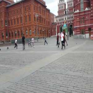 Peruvian fans have a kickabout at the Red Square