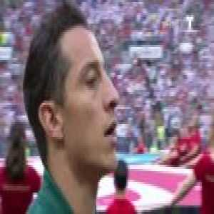 Mexican national anthem being sung by the players and fans