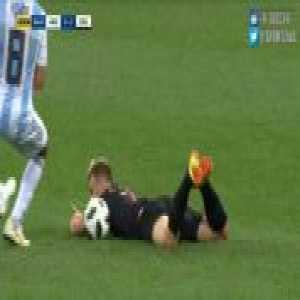 Otamendi kicks the ball at Rakitic whilst Rakitic is on the floor