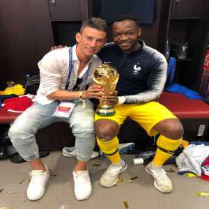 Koscielny celebrating with Mandada, with the world cup in hands