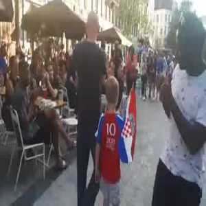 A Croatian family walking through Brussels gets the most heart melting congratulations as their country reaches World Cup finals