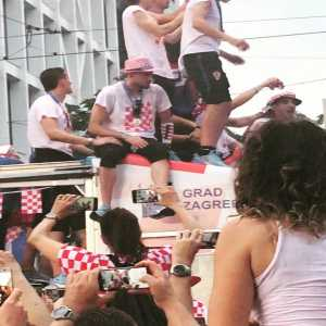 Domagoj Vida slips from the bus rooftop and is saved by Subasic.