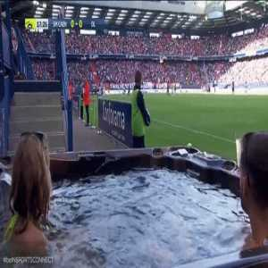 A few SM Caen fans are watching their match vs. Lyon in a jacuzzi right next to the pitch