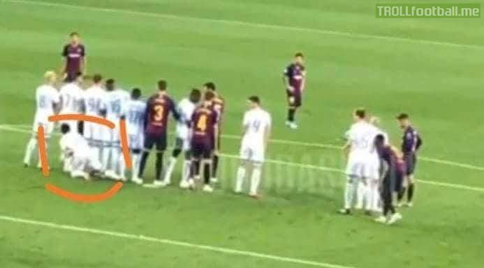 PSV really tried to stop Lionel Messi's free kick like this.