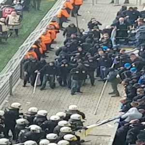 Hertha fans fighting riot police after they attempted to remove a banner on display.