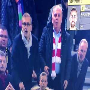 Bayern board members get showered in Beer after Dortmund goal.