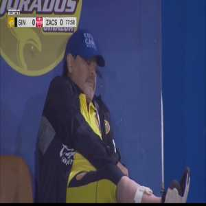 Maradona casually takes a call in the middle of coaching a Dorados game
