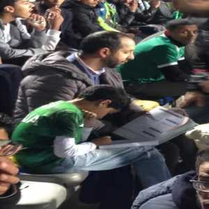 A young boy doing his homework while attending Raja C.A. (Morocco) vs Ismaily S.C. (Egypt) [SOCCER212 on Twitter]