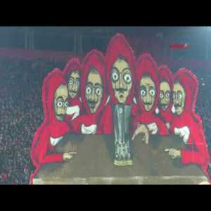 "Choreography from yesterday's Olympiacos-Milan game, inspired from the Spanish TV series ""La Casa de Papel"" (Money Heist)"