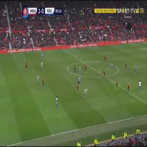 Marcus Rashford runs for the ball, attempts to control it and then slips over it