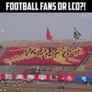 This is INSANE! Football fans taking it to the next level! 😳👏