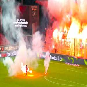 Swiss League game between Sion and last-ranked Grasshopper Club (2-0) abandoned after numerous flares are thrown onto the pitch by the GC block