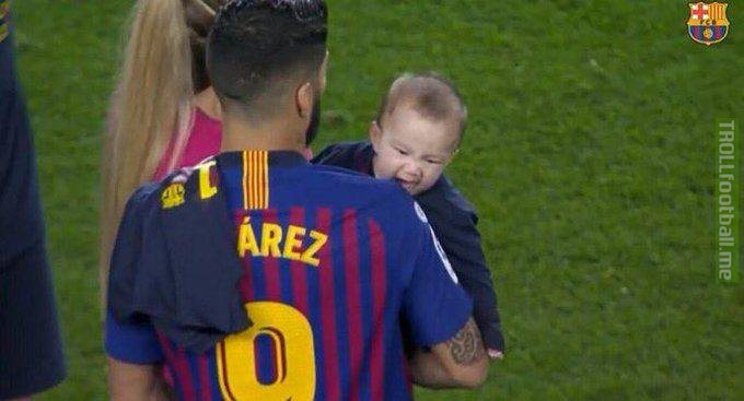 Let's thank the universe for giving us this picture of Luis Suarez's son trying to bite him 😂