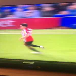 Portsmouth fan kicks Sunderland player when he falls into the crowd. Throws hissy fit when Sunderland players retaliate.