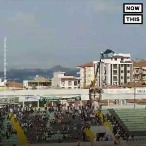 Denizlispor fan banned from the stadium rents a crane so he can watch the match