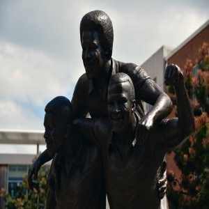 A 10 foot bronze statue of the 'Three Degrees' is officially unveiled in West Bromwich. The Three Degrees (Laurie Cunningham, Cyrille Regis and Brendon Batson) played for WBA in the late 1970s. It was the first time a top-flight club in England regularly fielded three black players.