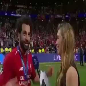 Mohamed Salah diving back as he thought a journalist tried to kiss him
