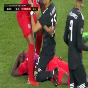 Moreno falling on Altidore after the whistle