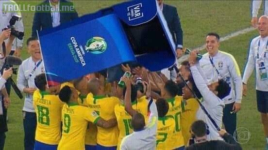 Amazing moment: Brazil celebrate their man of the match after winning Copa America.