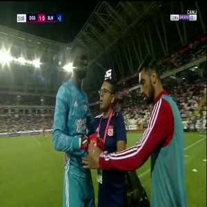 French/Sivasspor GK Mamadou Samassa collapses on field and leaves in ambulance after collision with Tyler Boyd.