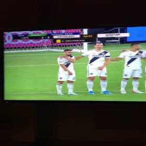 Zlatan Ibrahimovic pushes his teammate Sebastian Lletget out of the wall