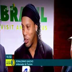 Ronaldinho is Brazil new tourism embassor, but he has his passport seized because of environmental fines and can't travel outside the country