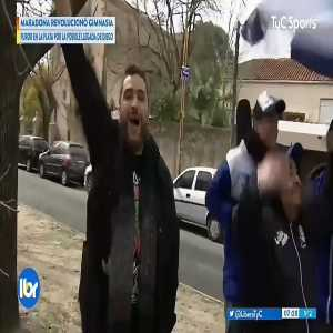 Gimnasia de La Plata fan celebrates Maradona's appointment as a coach with a chainsaw