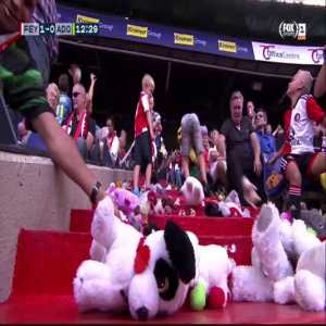 ADO Den Haag away fans throwing stuffed animals on the stands below them, as is a yearly tradition. In those stands are children from the Rotterdam Sophia Children's Hospital.