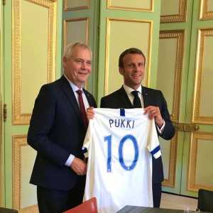 Prime Minister of Finland Antti Rinne gifting the French President Emmanuel Macron with the most iconic thing possible a Pukki shirt