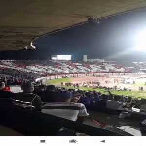 """In their first CAF CL home game, Wydad AC supporters protested against """"CAF Corruption"""" with a tifo and by wearing black"""