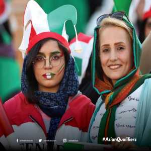 Images of female Iranian fans attending the match against Cambodia.
