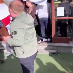 England fan attempted to hang english flag across Irish bar in Prague...shows he not the brightest