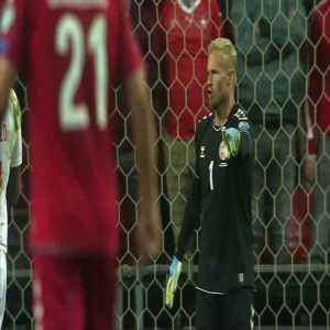 Kasper Schmeichel saves against Switzerland