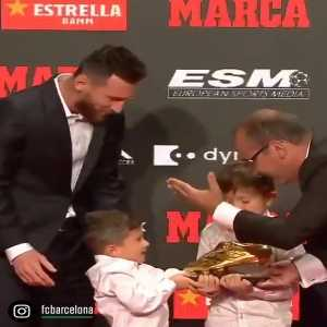 Mateo Messi taking away the golden shoe from his brother.