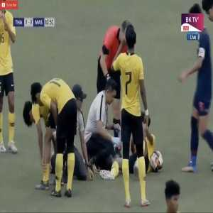 A funny moment during U19 Malaysia vs U19 Thailand, in which a medical officer is presented with a yellow card by a referee for allegedly trying to delay