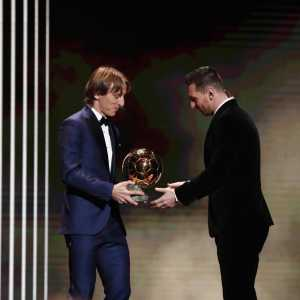 "Luka Modric posted a picture of him handing over the Ballon d'Or to Lionel Messi: ""Sports and football are not just about winning, they're also about respect for your teammates and rivals."""