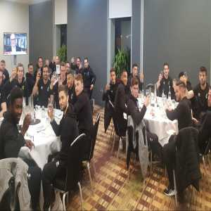 Norwich squad toast a drink to Barrie Greaves who left £100 in his will to the squad to buy themselves a drink.
