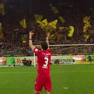Subotic gets celebrated infront of Dortmunds yellow wall