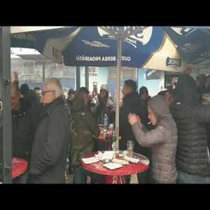 """Inter suporters eating """"mici"""" in Bucharest after a mall was evacuated after a bomb threat."""