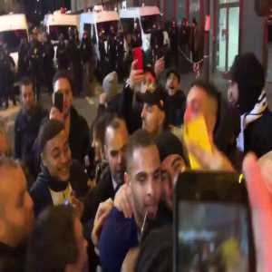Laywin Kurzawa celebrating PSG's win against Dortmund with the fans outside Parc des Princes