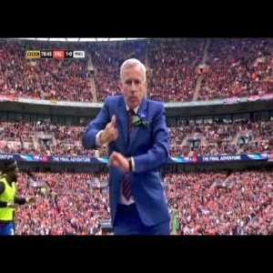 Alan Pardew does a little celebratory dance after his team scoring as Crystal Palace down Man United 1-0