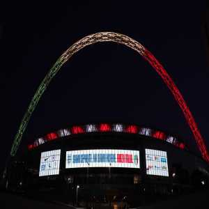 "Wembley's famous arch has been illuminated with the colours of the Italian flag in a show of solidarity by England amid the coronavirus crisis ""We are separated, but we are together. Forza Italia."" England and Italy were due to play in a friendly at Wembley tonight"